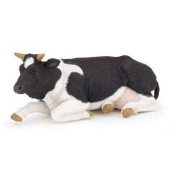 Vache couchée noire et blanche***